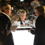 "Risa directing Sarah Roemer and Rebecca Romijn in ""The Con Artist"""